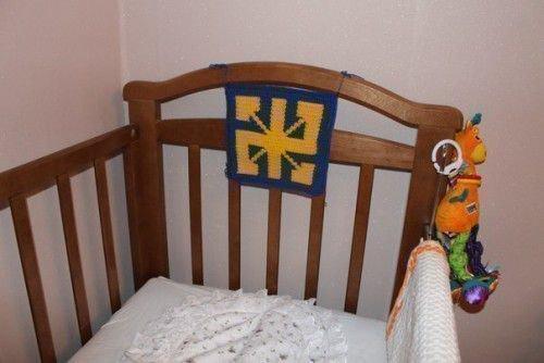Радинец над кроваткой